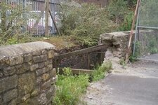 art-of-the-damaged-wall-fell-into-the-malago-brook.jpg