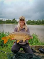 ing-with-a-carp-at-a-commercial-fishery-2-768x1024.jpg