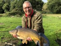 Andy-Torrance-with-his-first-carp-x650-300x225.jpg