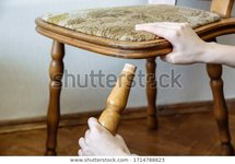 broken-chair-woman-holding-hands-600w-1714788823.jpg